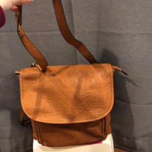 Brown crossbody convertible backpack straps.